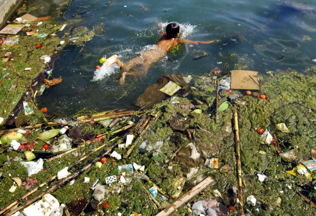 A child swims in a polluted reservoir in Pingba, southwest China's Guizhou province, Sept. 2, 2006. Read more: http://www.businessinsider.com/china-water-pollution-photos-2014-7?op=1#ixzz3AnUSZxry